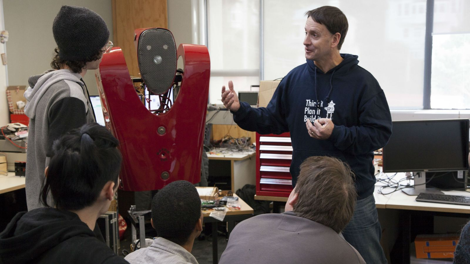 Dale Carnegie teaches students about robots.