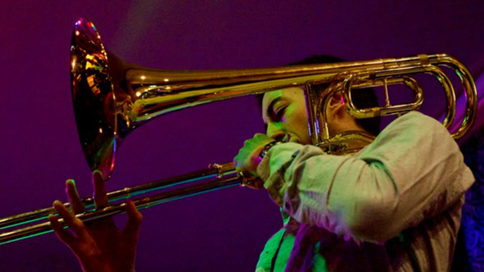 Close-up of performing trombone player in full swing