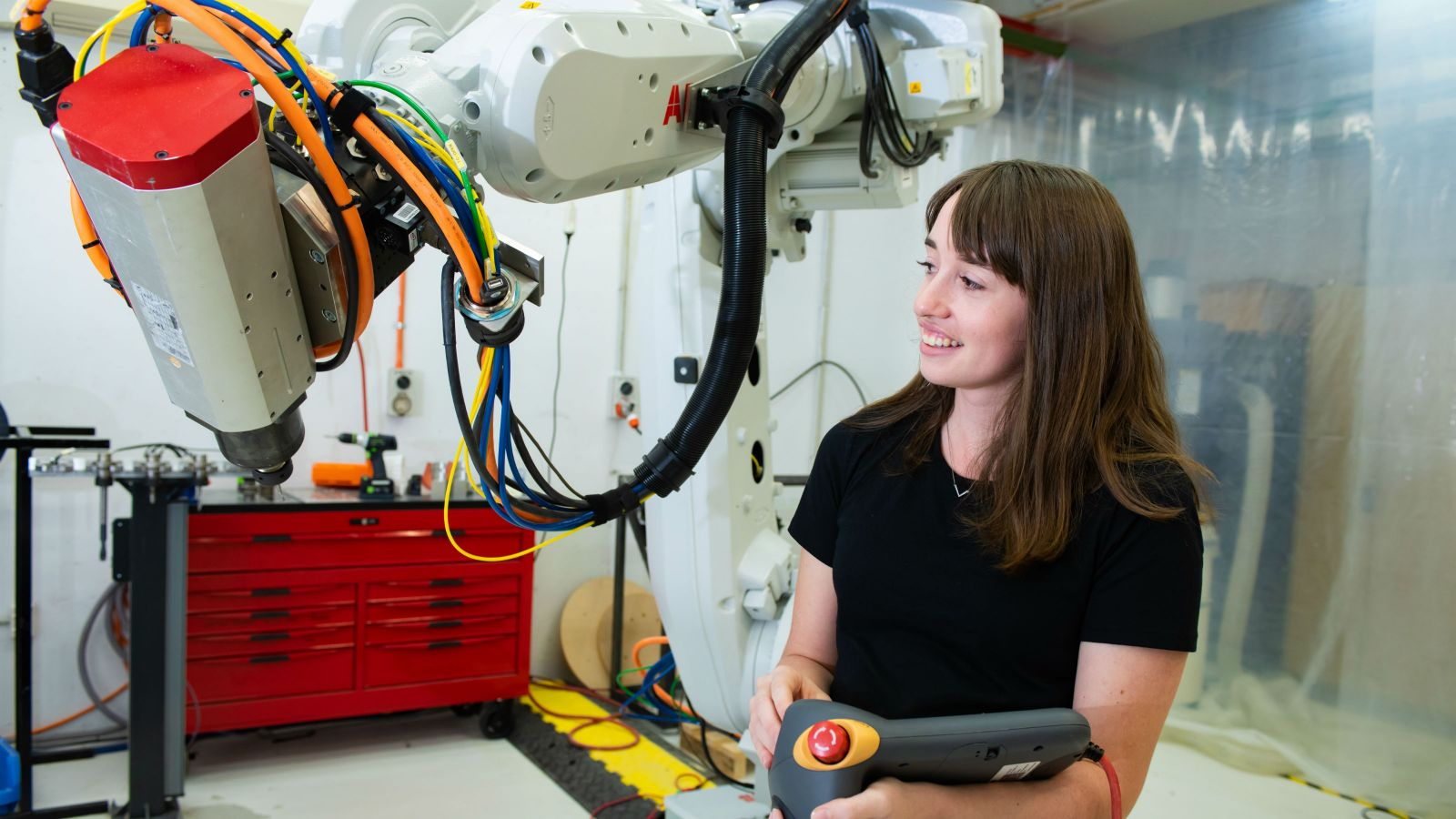 Student operates robotic arm