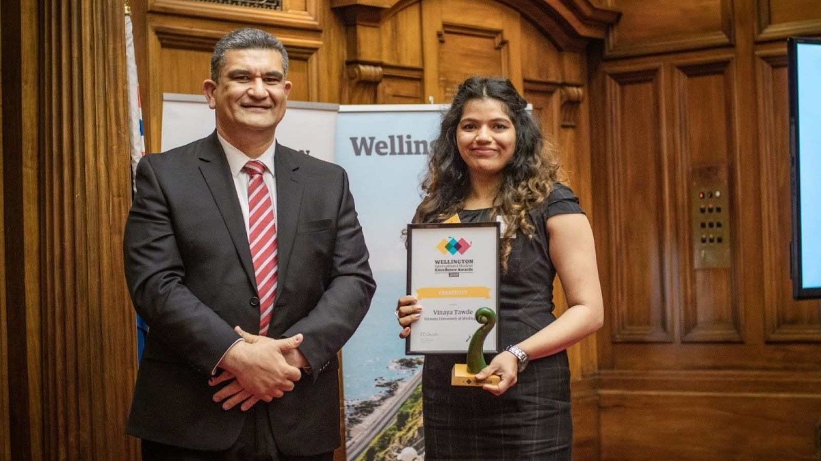 Vinaya Tawde accepts her award from Paul Eagle MP during the Awards Ceremony in the Great Hall, Parliament Buildings