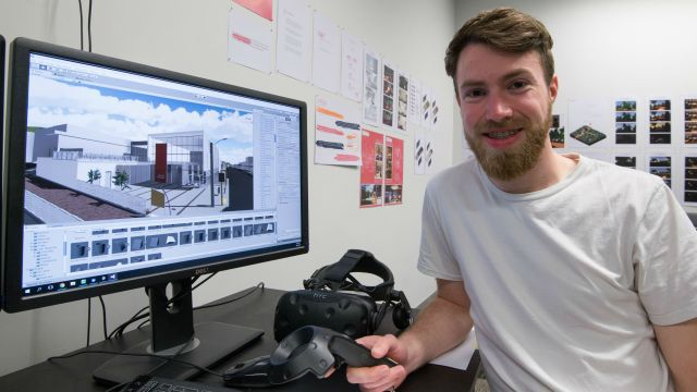 Daniel with computer and vr headset