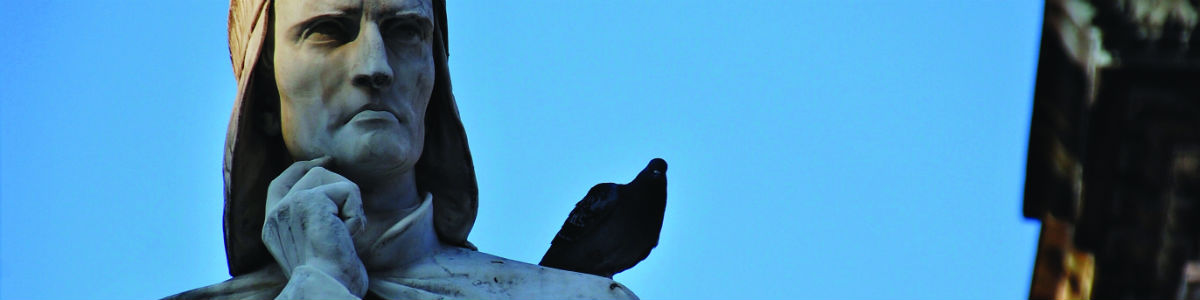 Bannier image - a bird is perched on the shoulder of a statue.