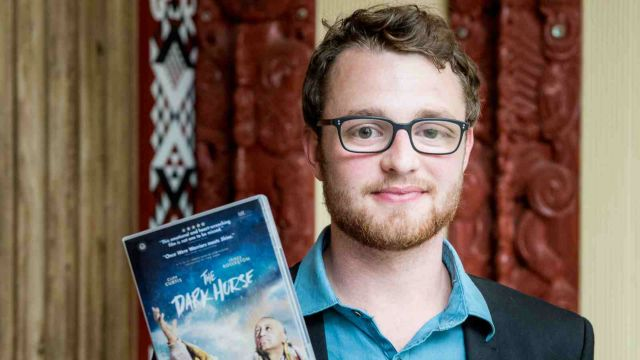 Rory holds a dvd copy of the Dark Horse.