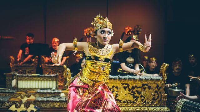 Dancer with gamelan ensemble