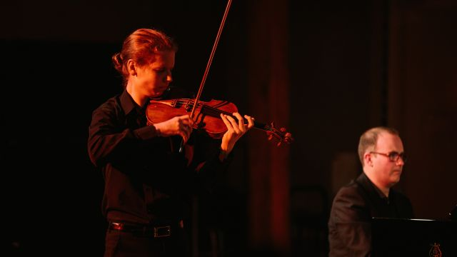 A violinist and pianist perfom.