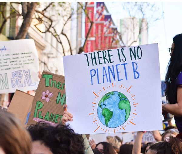 Climate strike placard held up during protest