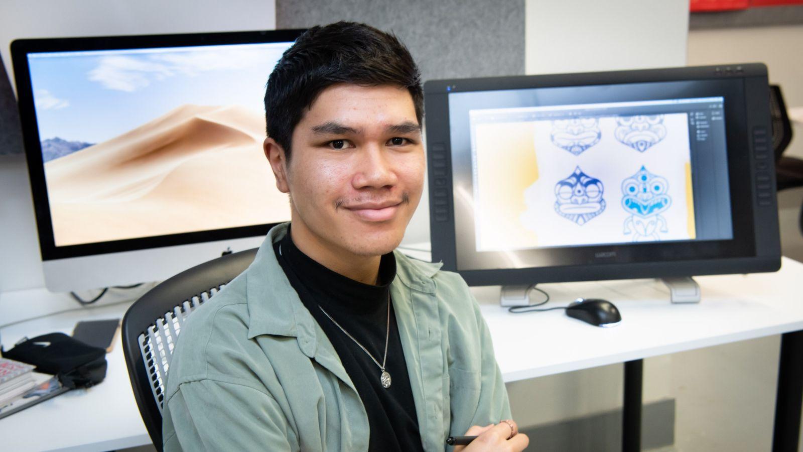 carym Wharera sat in front of mac in design. studio