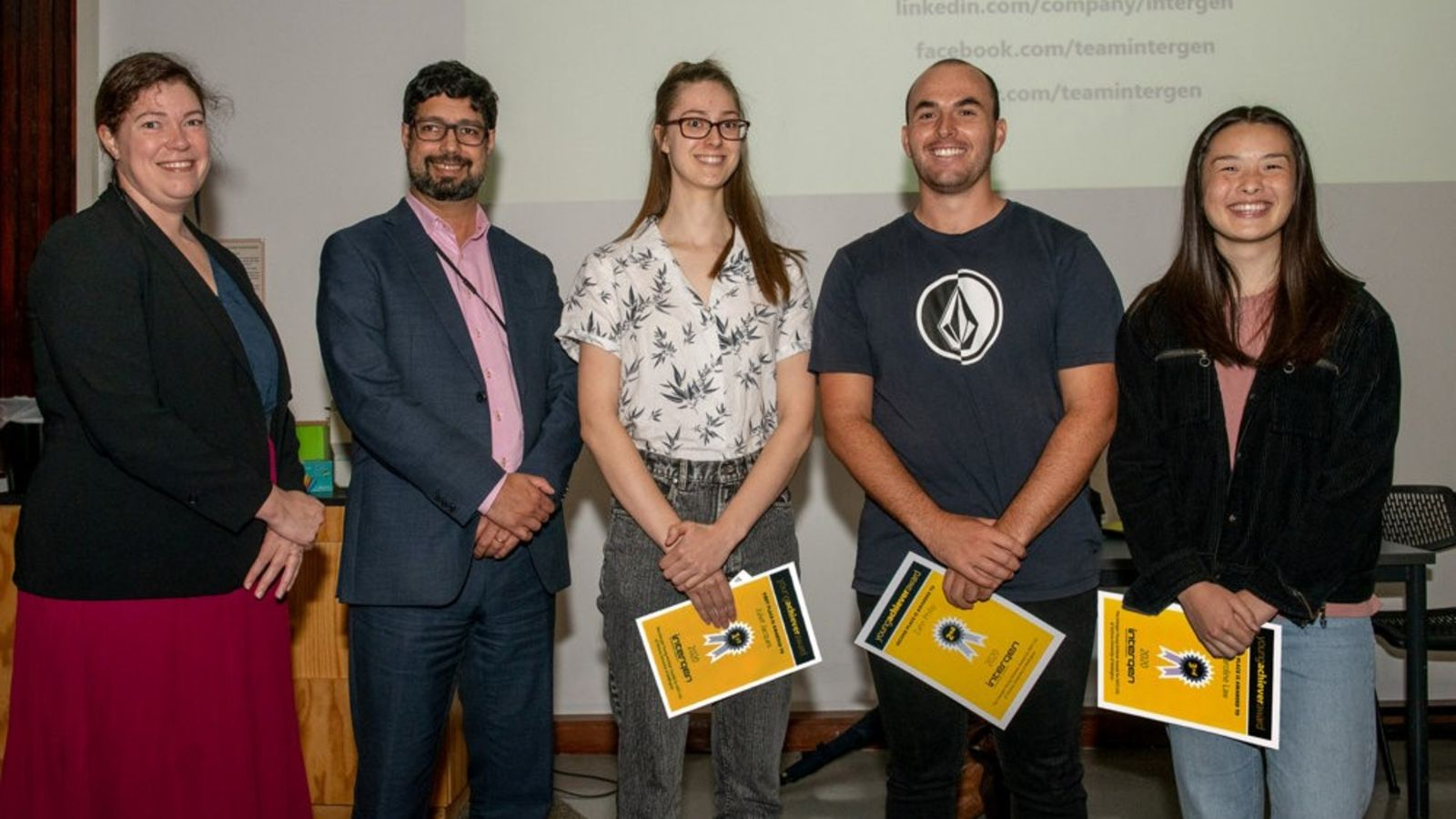 Three students receive Young Achiever awards, flanked by Intergen representatives
