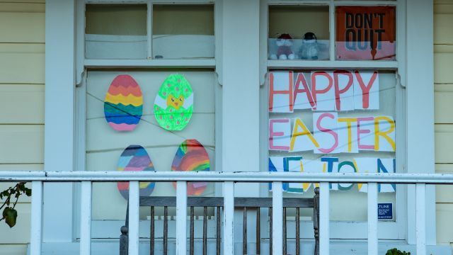 Residents in Newtown put up colourful drawings of Easter eggs at their windows, along with the message