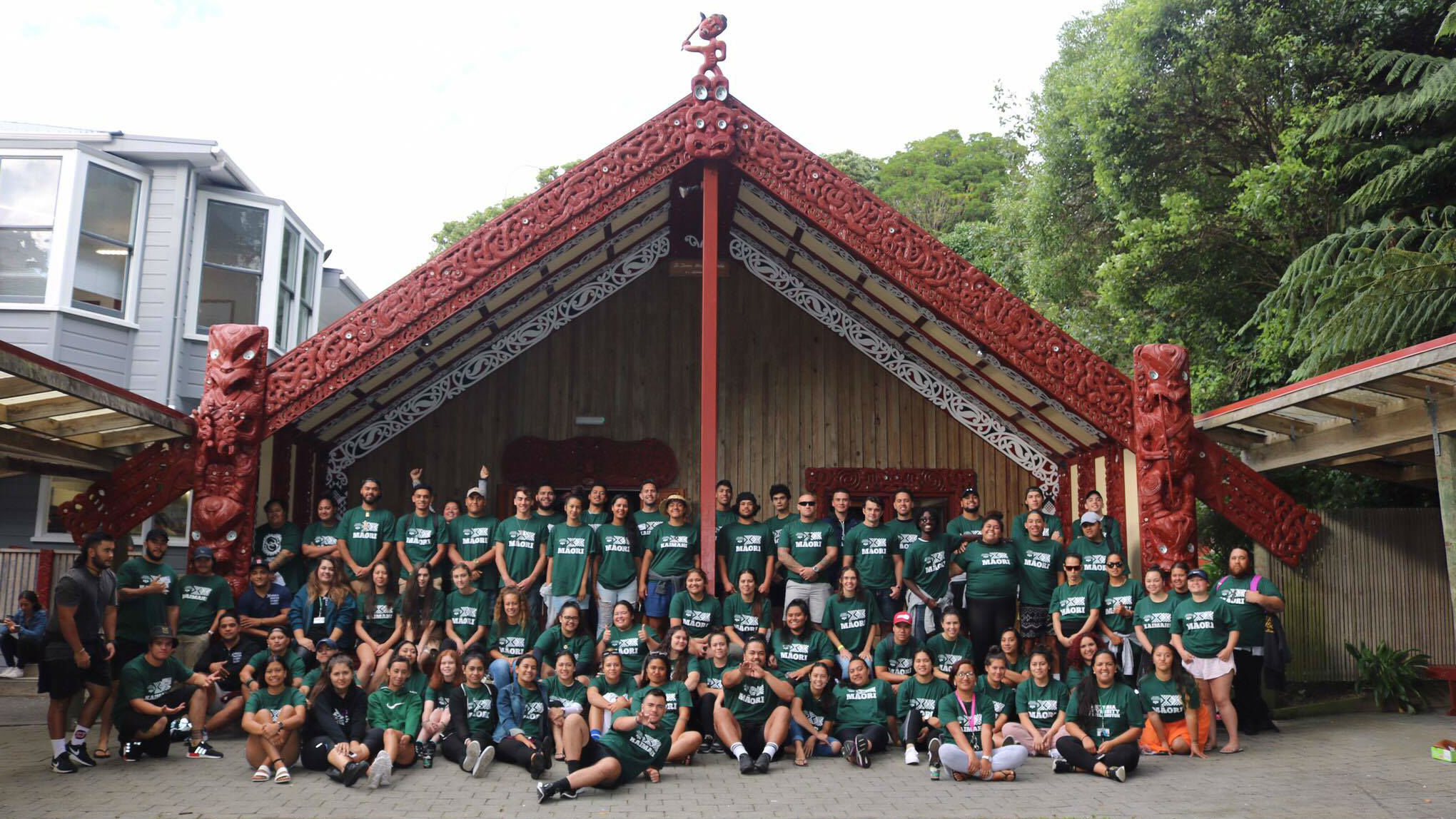 Whanau on campus – many students pose for a picture outside of the Marae.