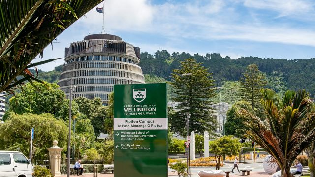 Pipitea campus sign with parliament in the background