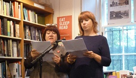 Image of authors Zoe Strachan and Louise Welsh reading at the 2013 Edinburgh Book Festival.