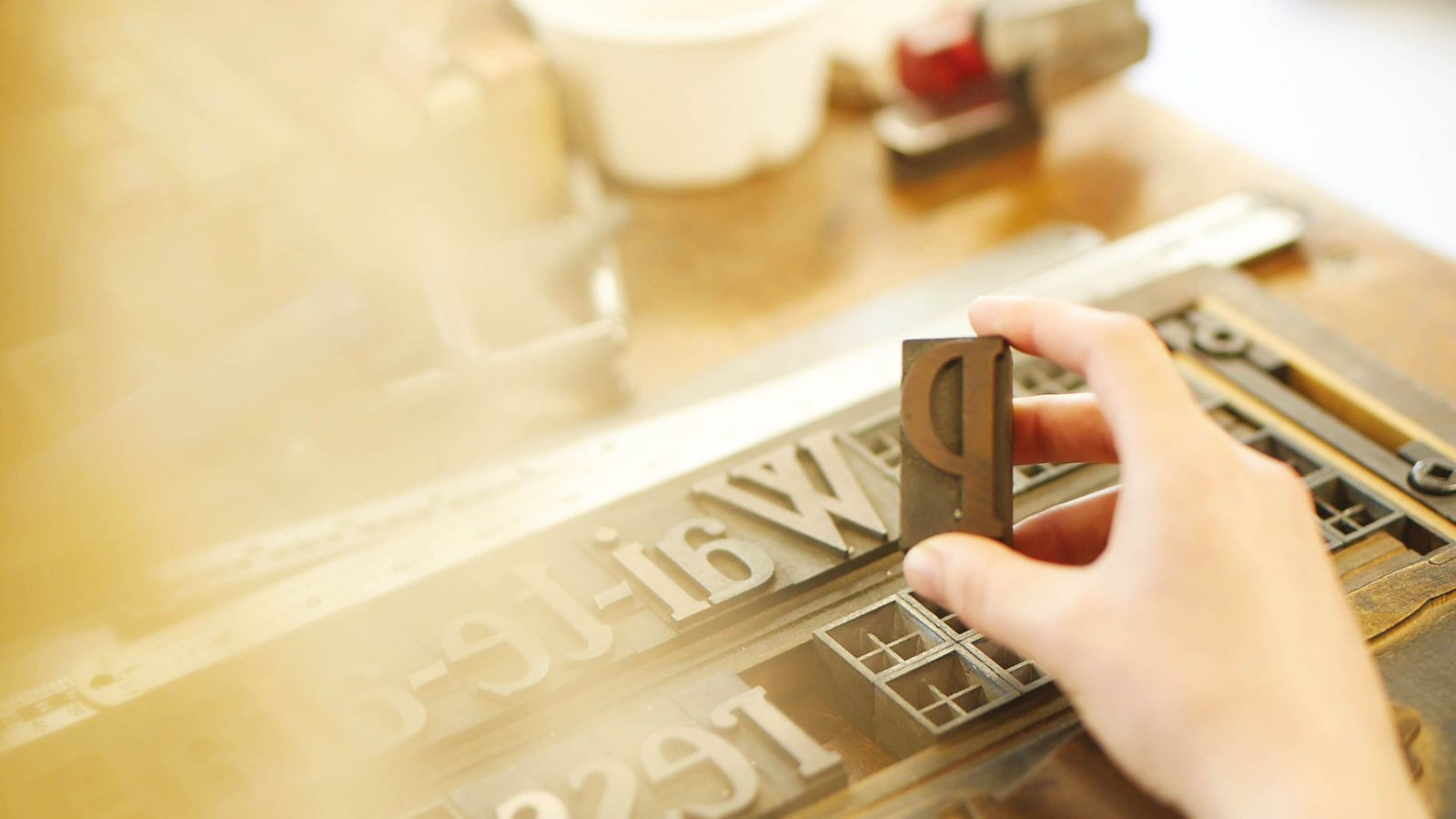 A close-up of printing press block letters on a table.