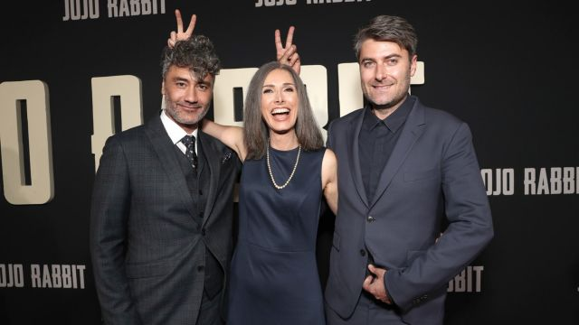 one woman between two men at opening of film Jojo Rabbit