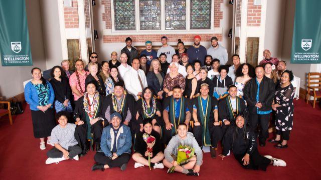 Graduates Siegfied Jahnke, Brandon Vaa, Hana Ah-Hi, Lotomau Koro, Savesi Apolo, and Samu Telefoni with family, friends, and staff.