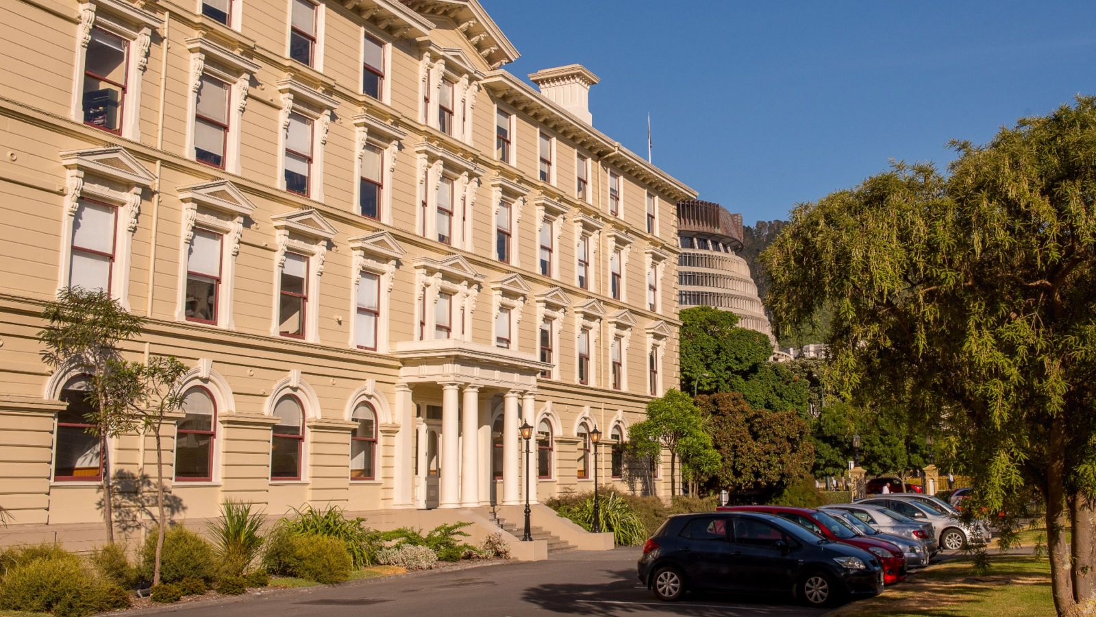 Old government building with beehive in background
