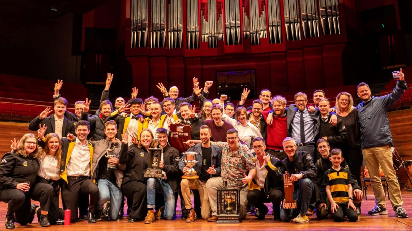 Musicians posing with trophies in the Christchurch Town Hall