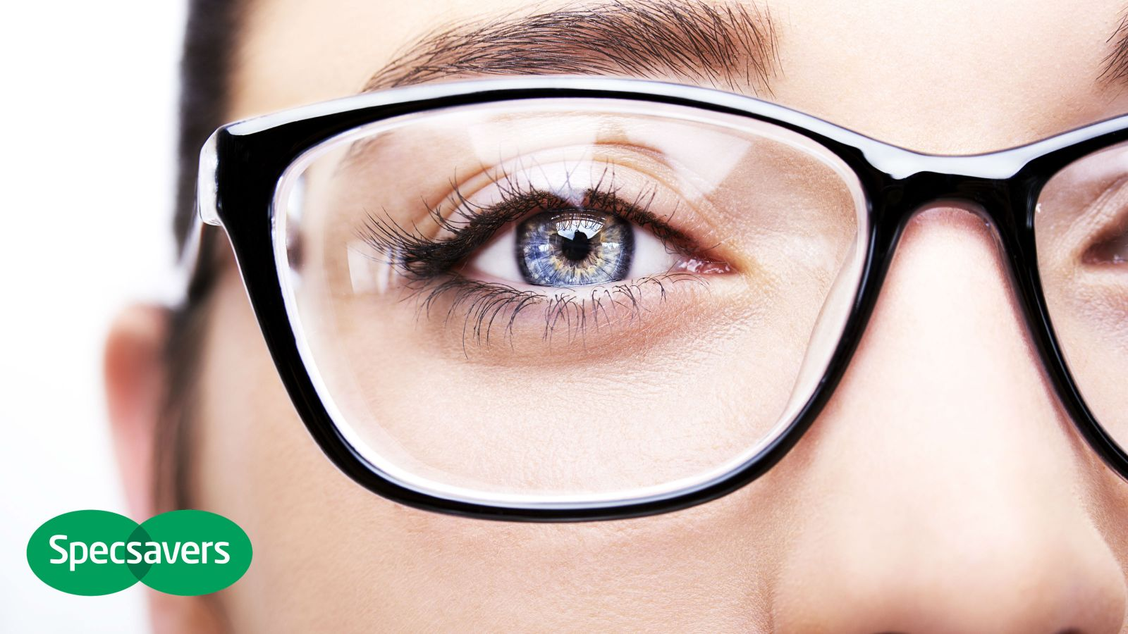 A woman wearing glasses from Specsavers.