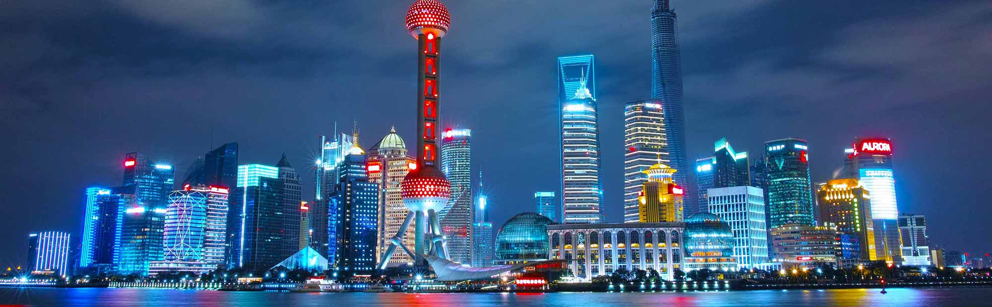 A cityscape image of Shanghai at night.