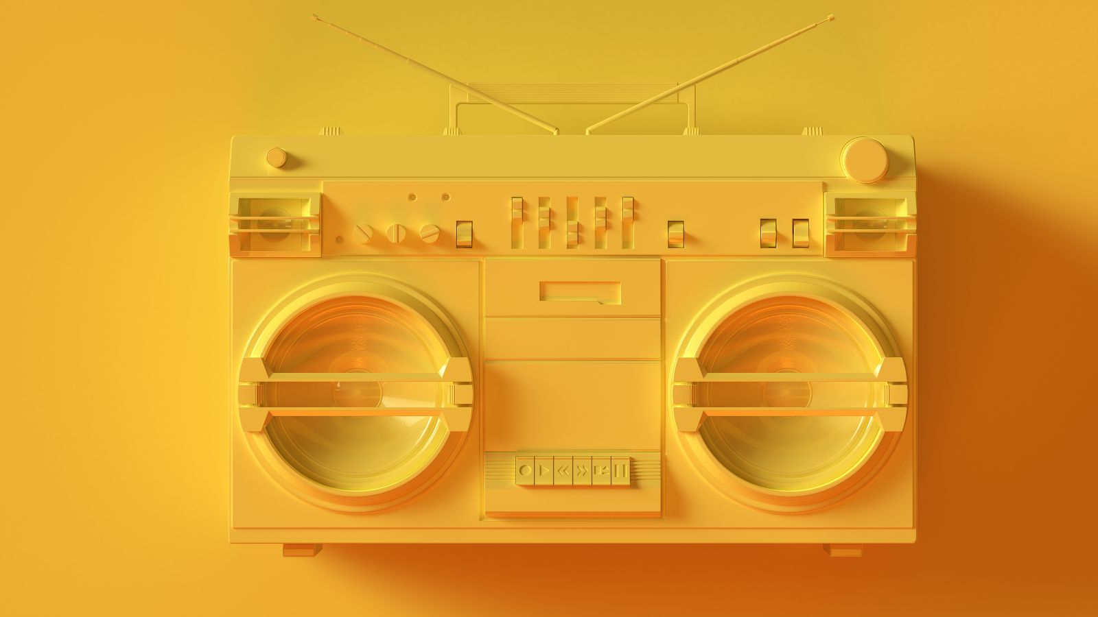 Spraypainted matte yellow 1980s cassette player on yellow background