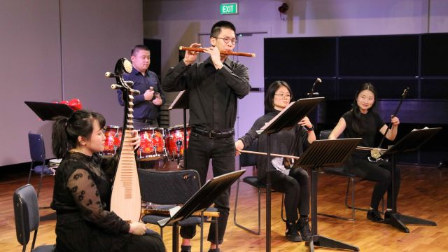 Ensemble leader Bo Yang on percussion with students Zoe Li and Xiaotong Yang on erhu, Xiuyu Li on  pipa, Zhong Gui on piano and Jeff Lin on dizi (flute)