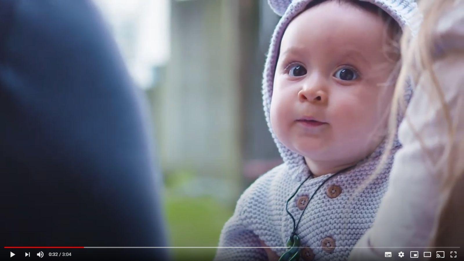 A baby looking at the camera