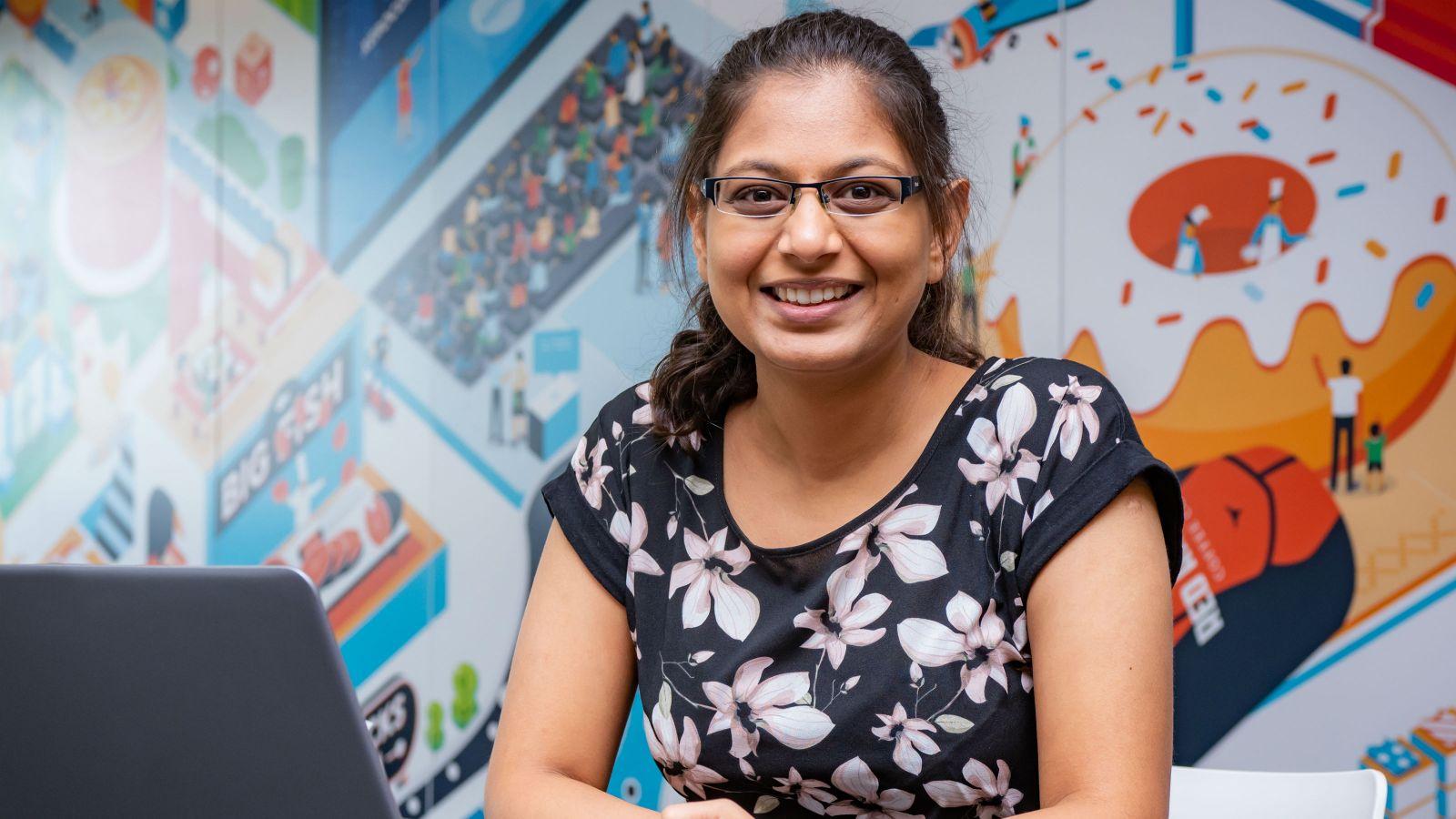 Divya Patel at her desk at Xero.