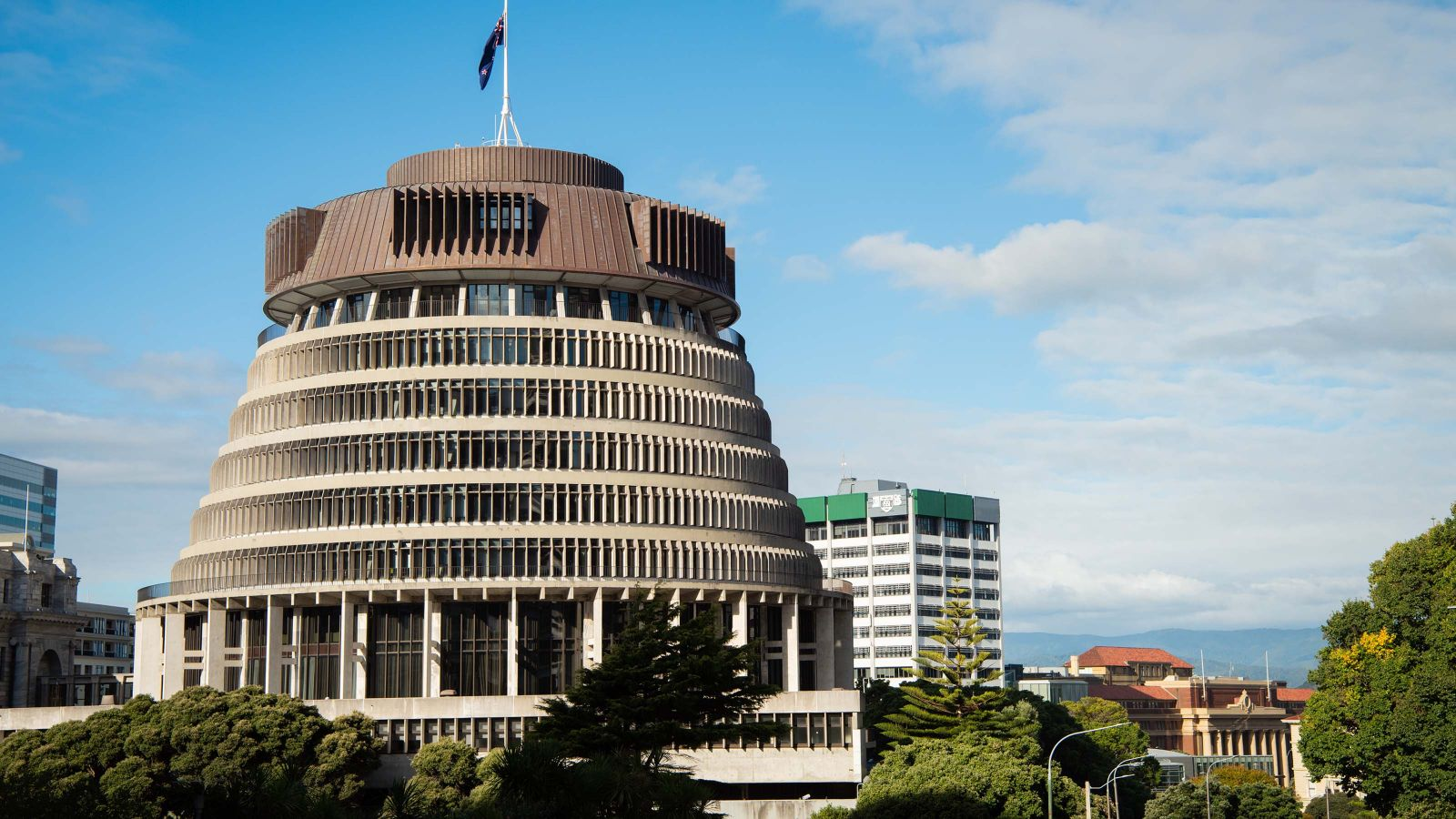 The Beehive, the Executive Wing of New Zealand Parliament Buildings, with Wellington School of Business and Government in the background.