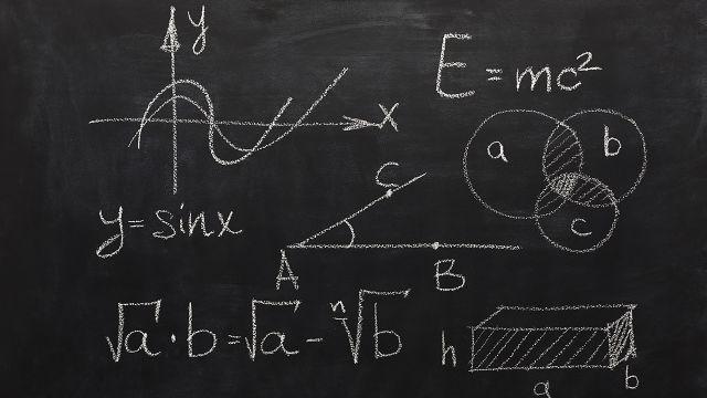 Blackboard with chalk writing of mathematical formulas