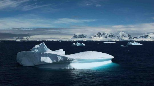 Ice berg floating in cold Antarctic waters