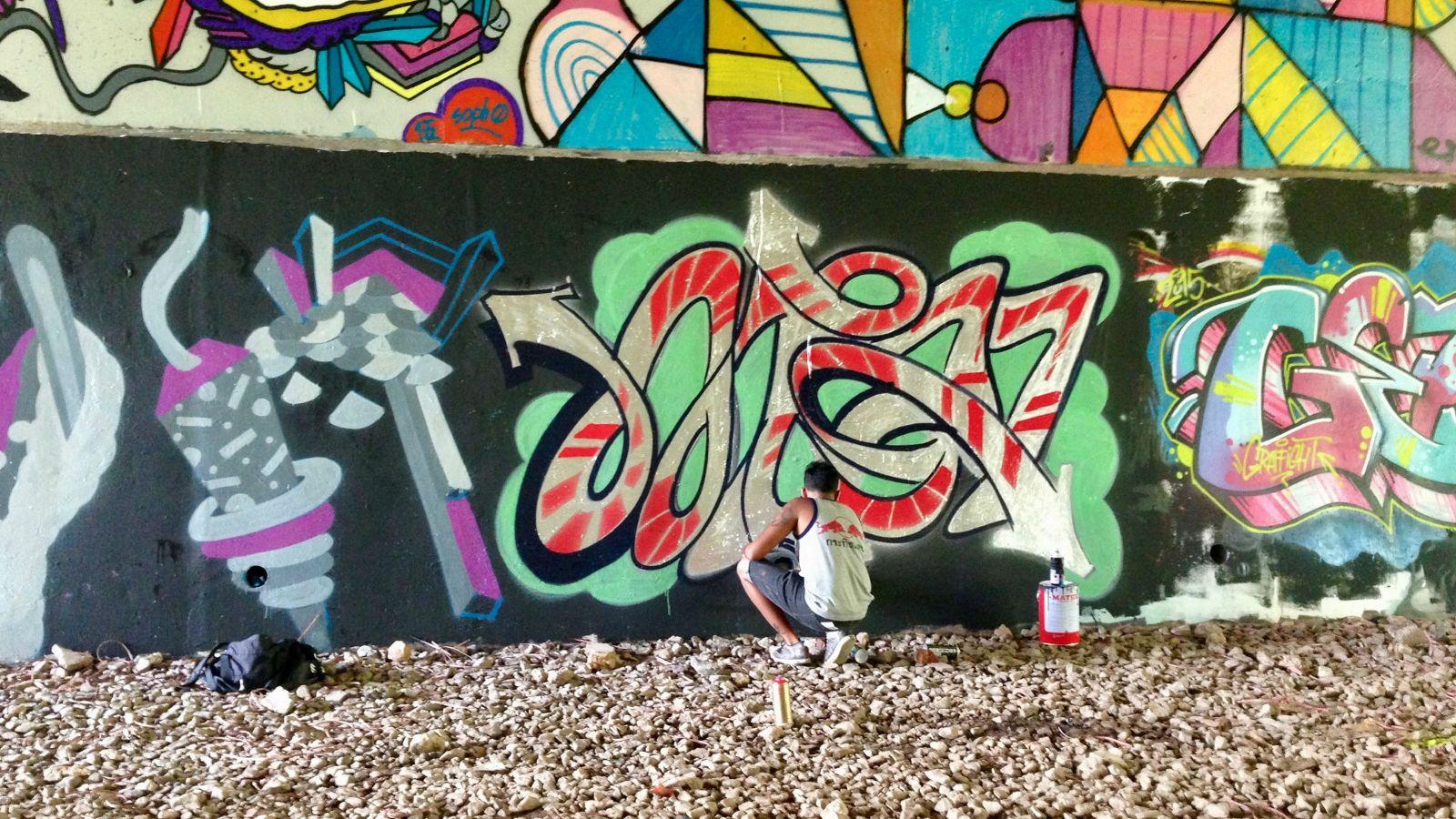Image of a wall of graffiti.