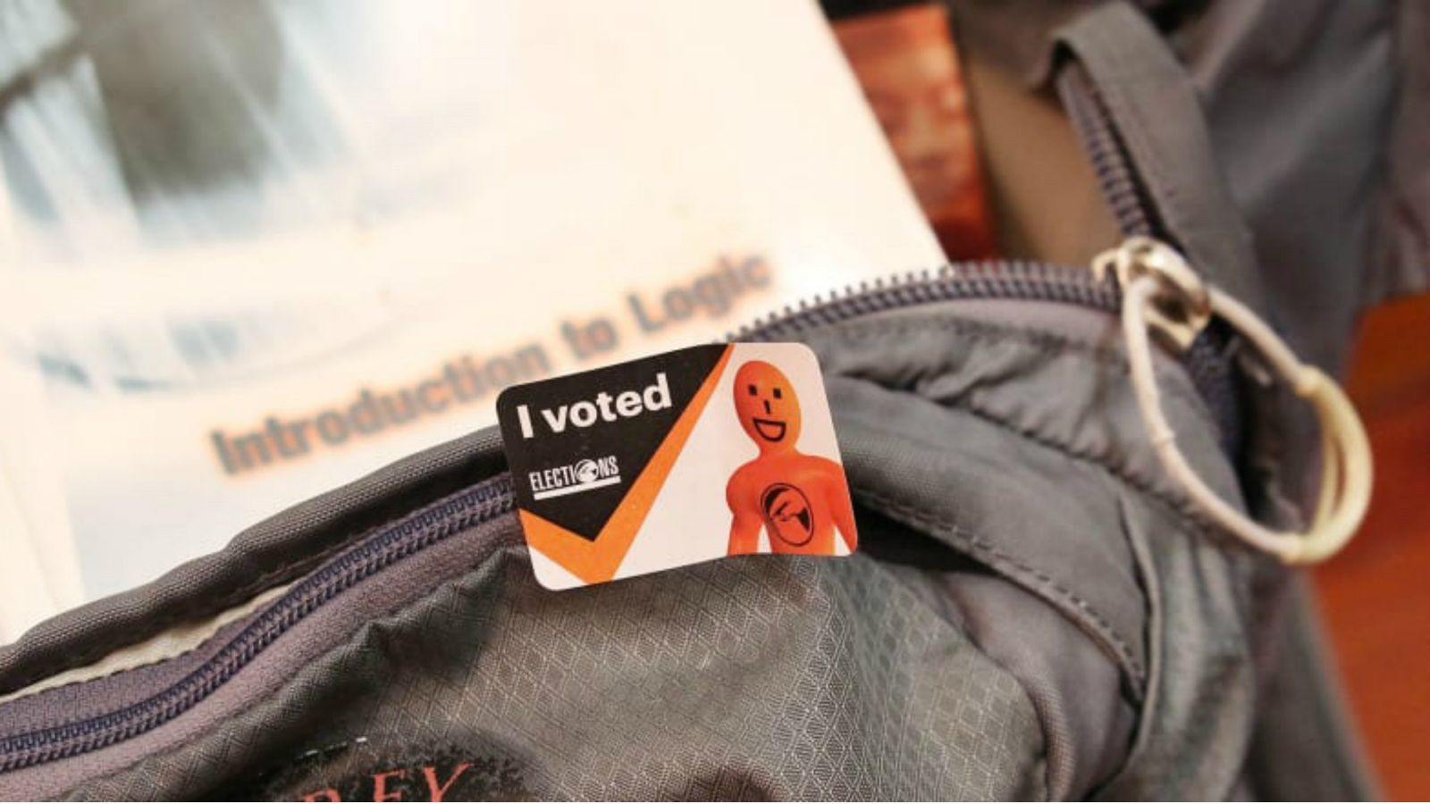 Image of an I voted card resting on a backpack.