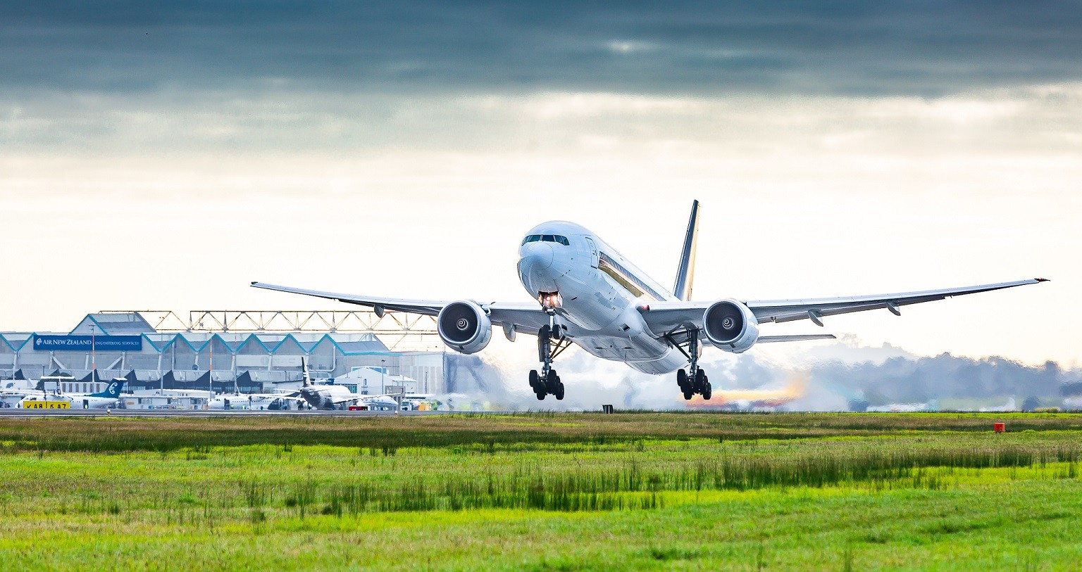 An image of a large passenger plane landing in NZ.