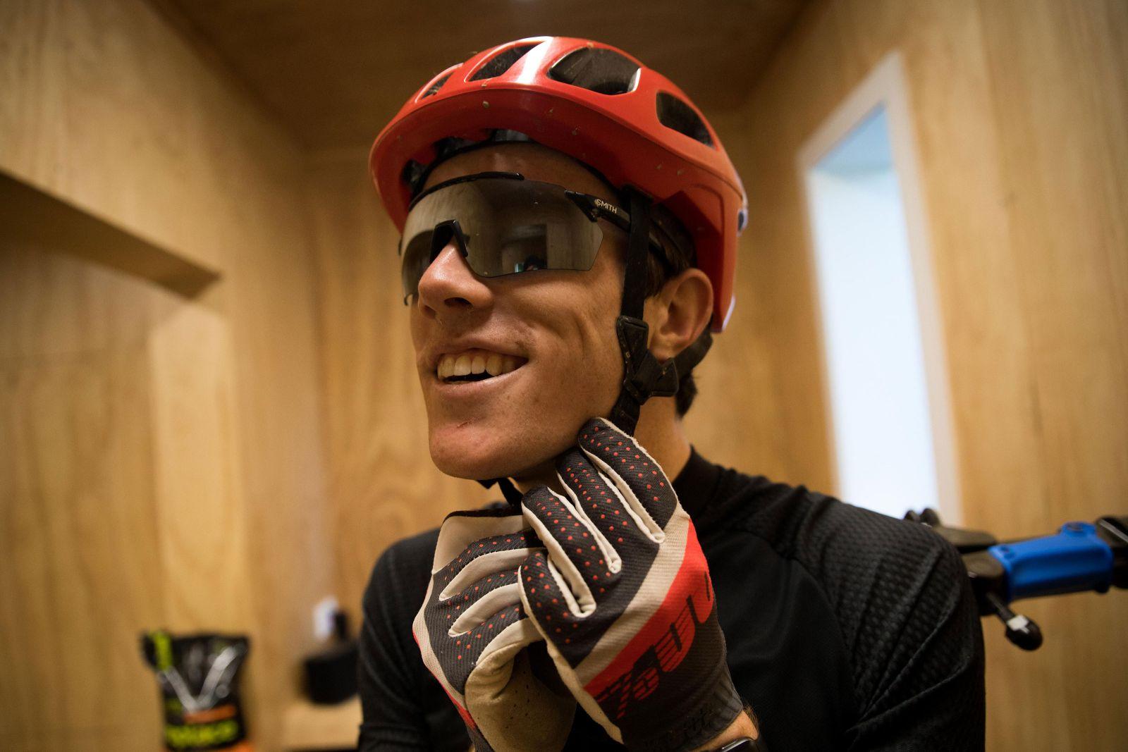 Putting on helmet in the bike lockup