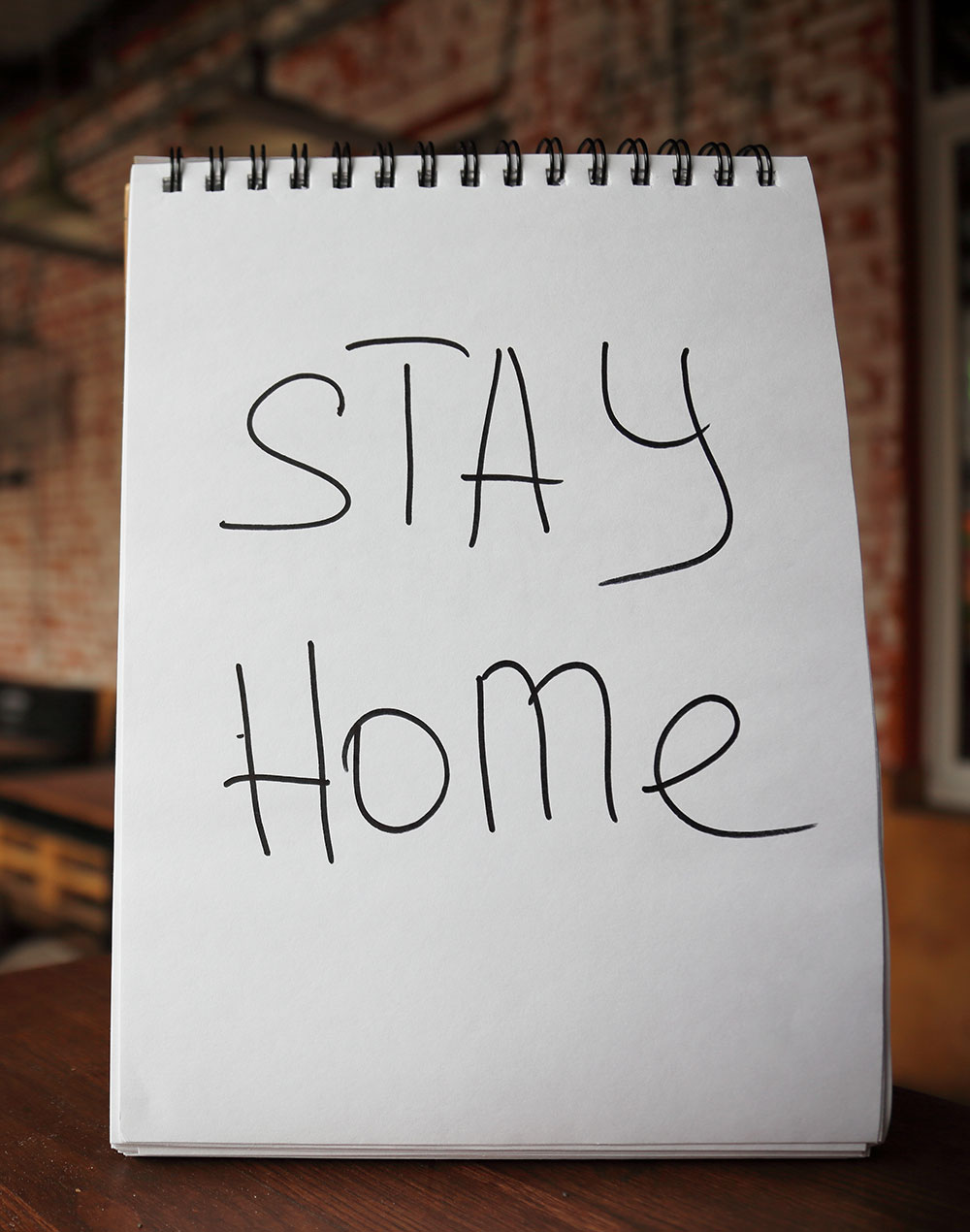 Stay home message in a shop window