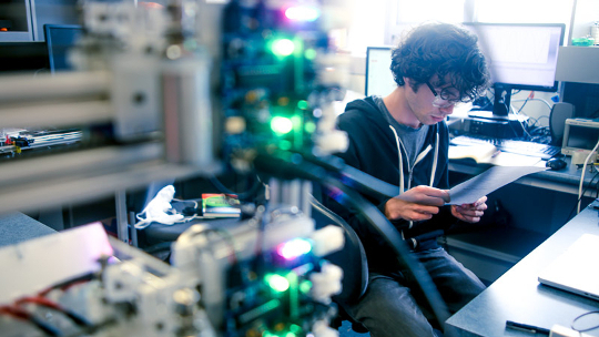 A student works with cutting-edge engineering technology.