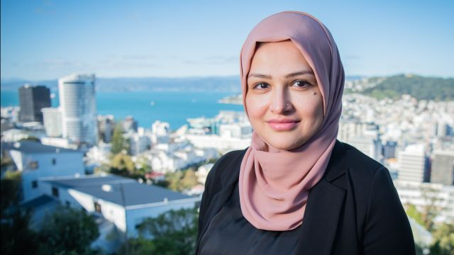 PhD student Qurrat UI Ain with Wellington in the background.