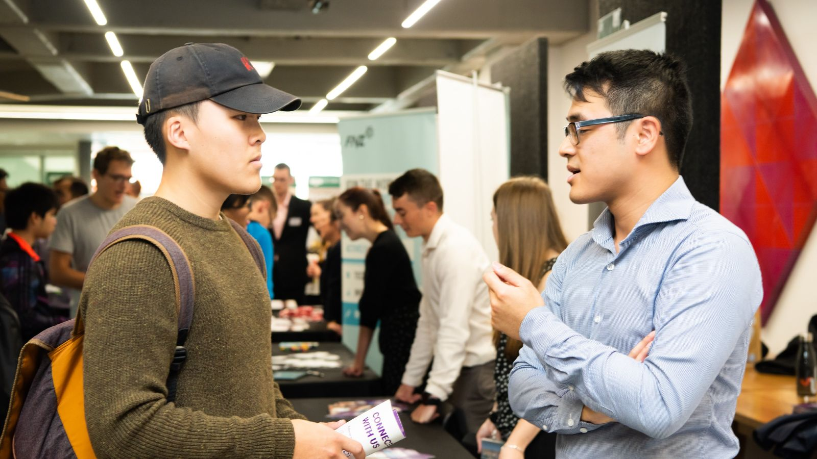Student talking to a recruiter at an expo.