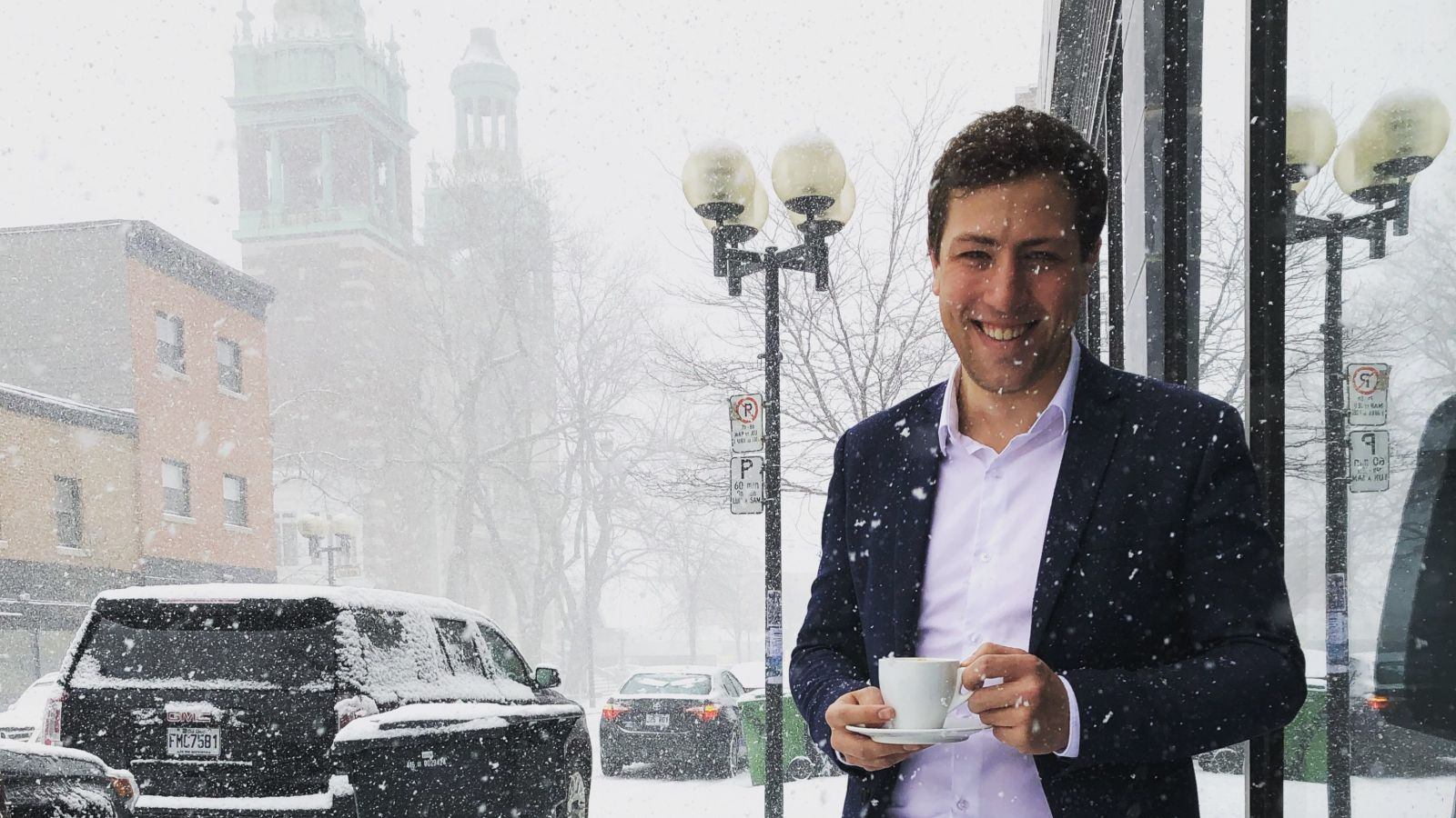 Hamish McConnochie Organizational Design Consultant Deloitte Canada in Montréal in the snow with a cup of coffee