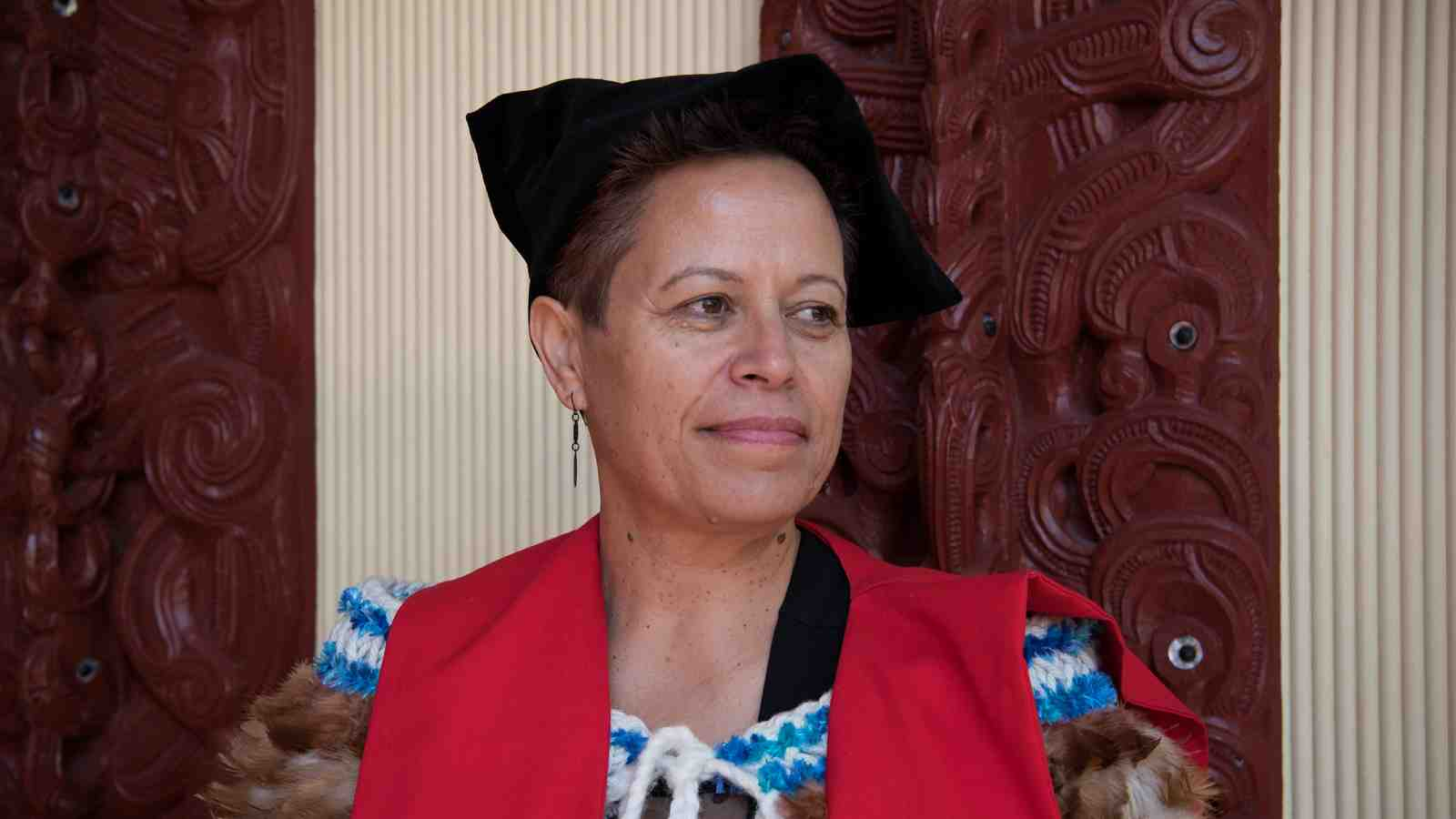 Maureen Muller in her graduation gown and cap.