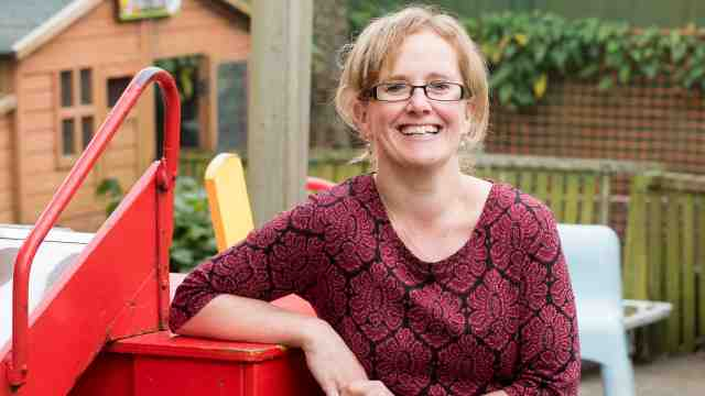 Miranda Major smiles in the playground of her preschool.