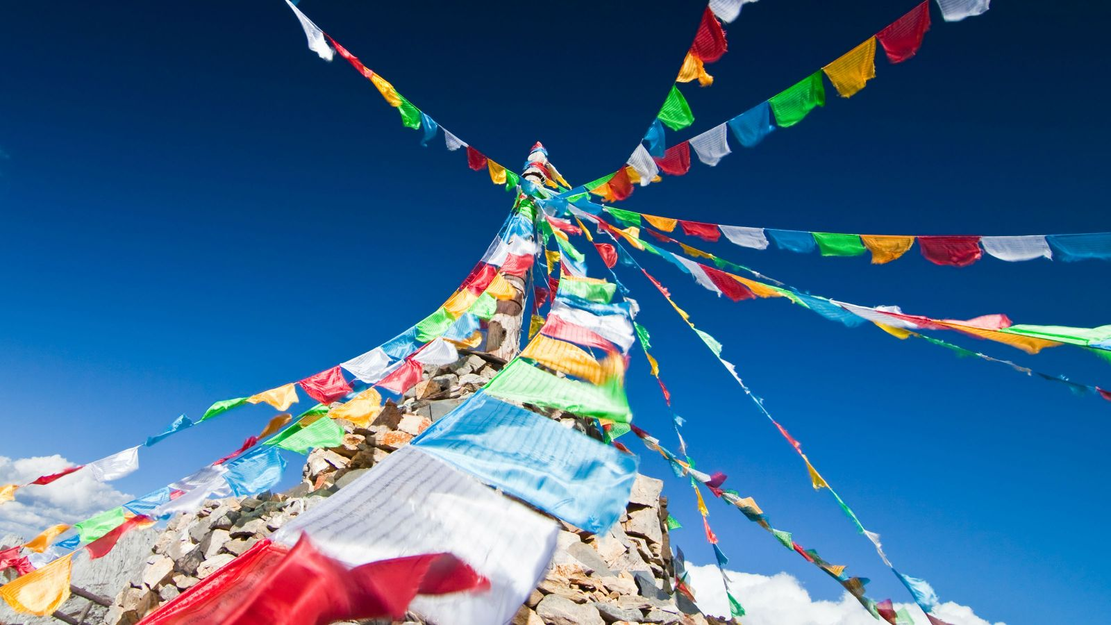 Prayer flags against a blue sky