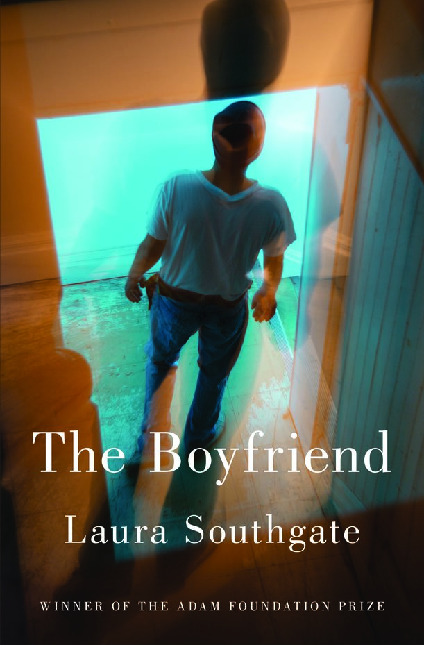 Cover of The Boyfriend paperback book. A mand stands in a white shirt and blue jeans.