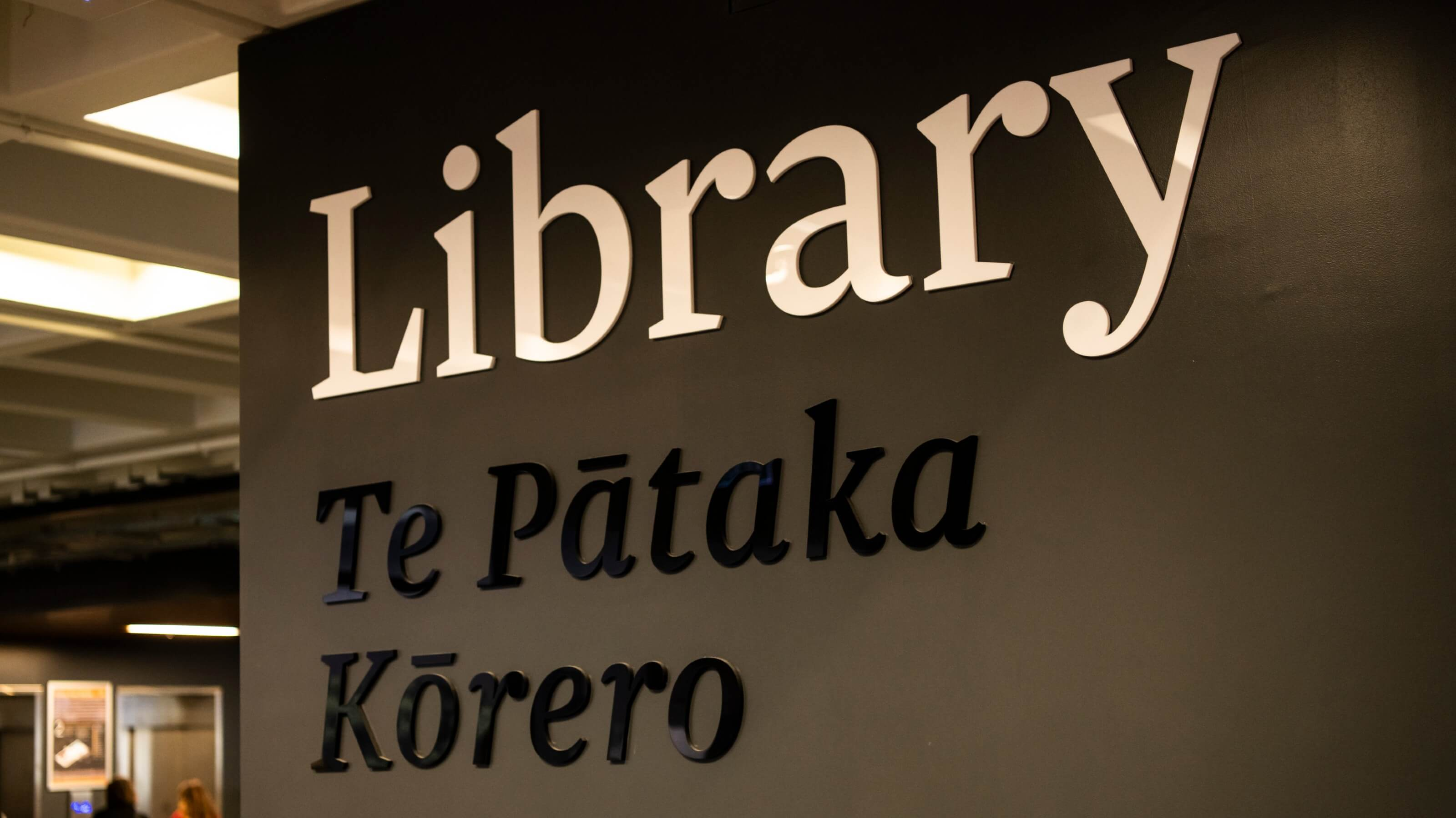 "Sign outside Kelburn Library that reads ""Library, Te Pātaka Kōrero""."