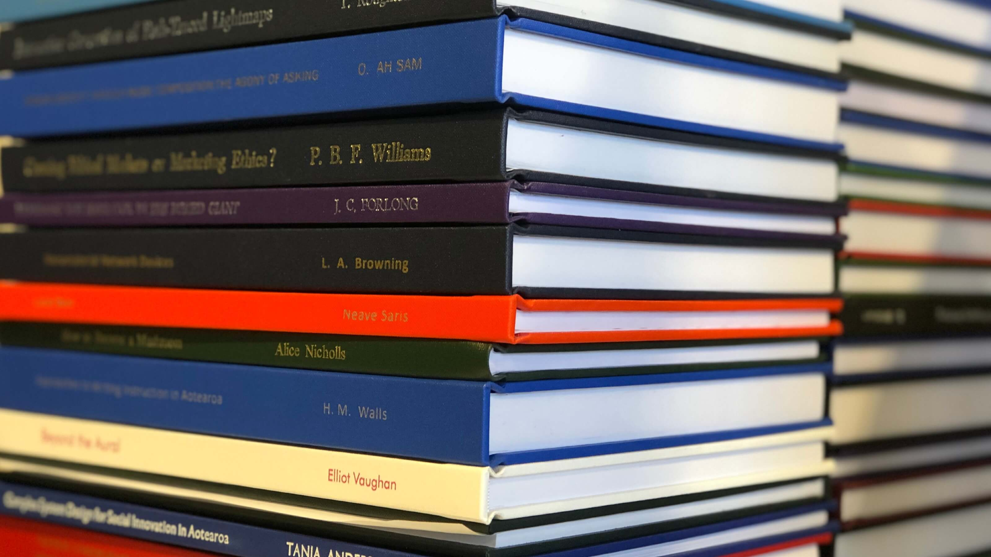 A close up image of a stack of hardcover books.