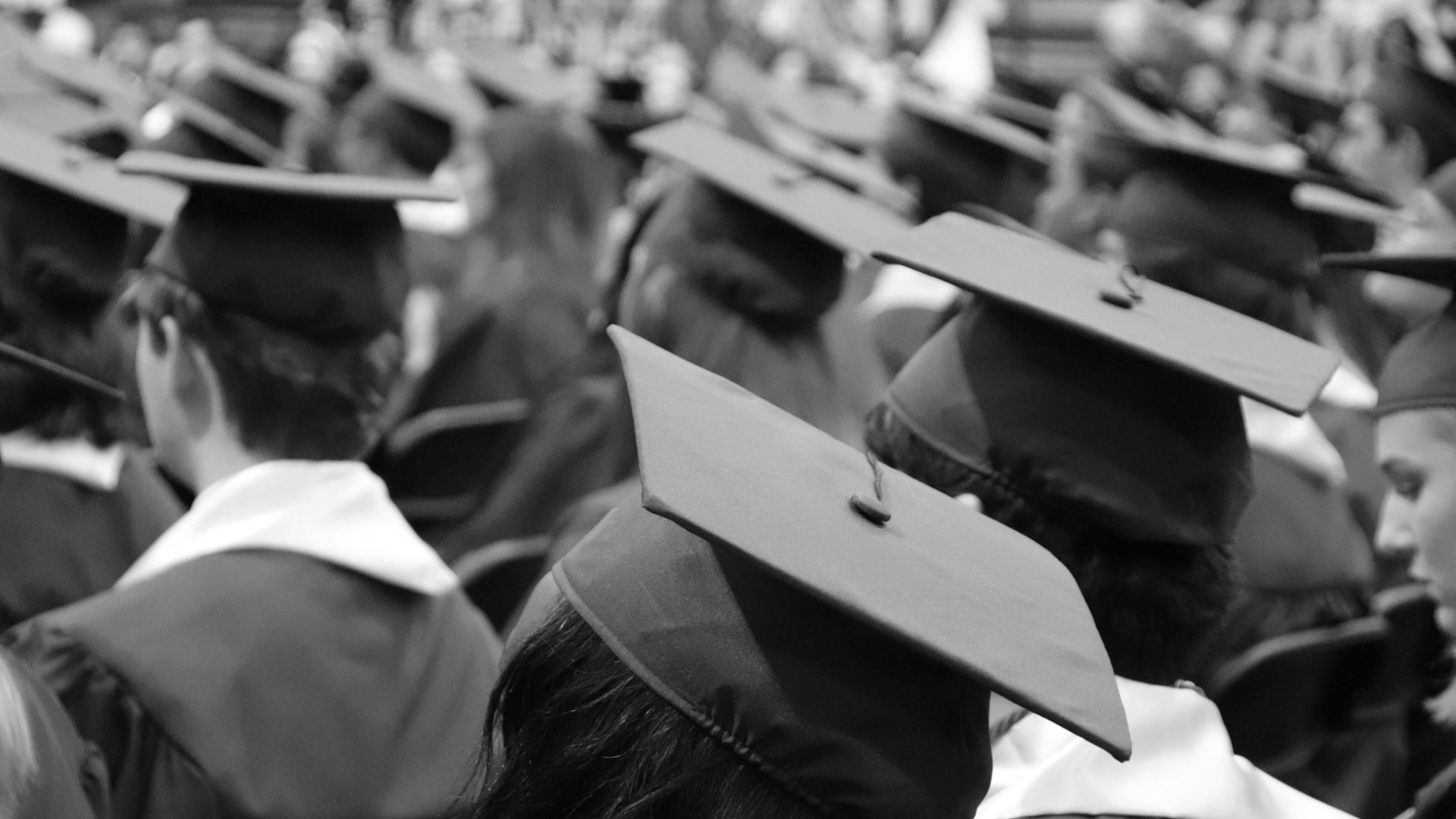 Black and white image of students graduating.