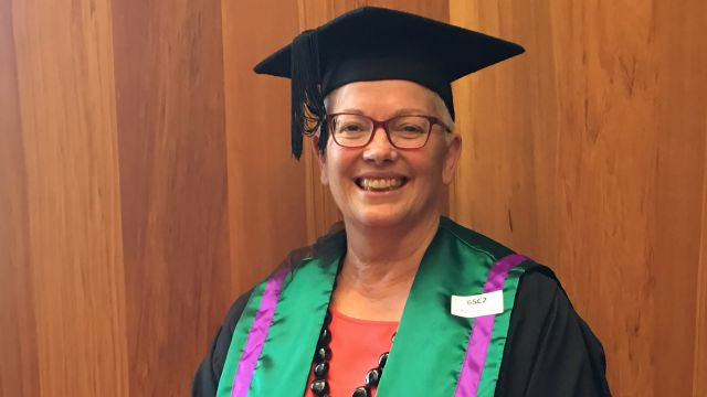 Anne Dymond in her graduation robes and trencher