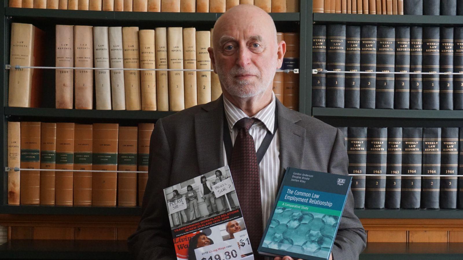 Professor Gordon Anderson with copies of his 2017 publications