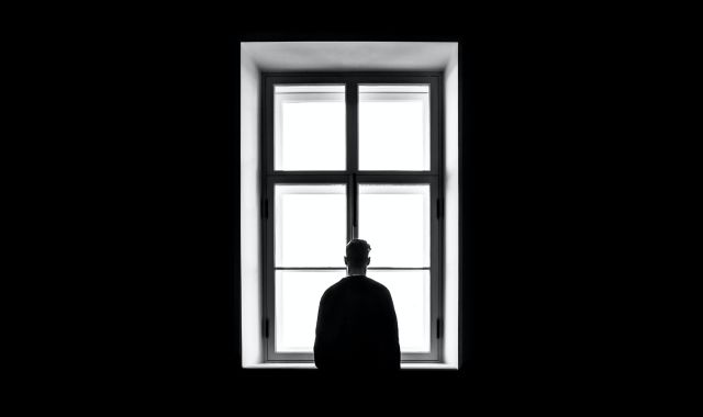 A man staring out a window