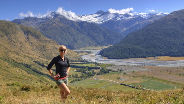 Emily Warren-Smith stands above the Matukituki River in the Southern Alps